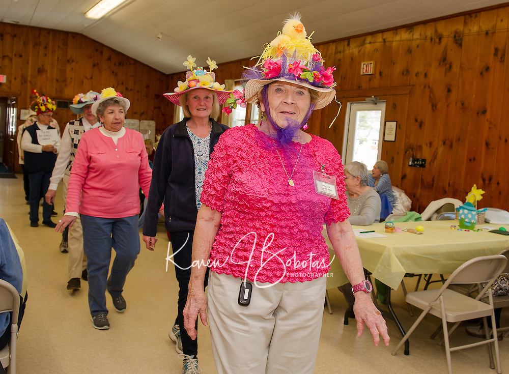 """Carole Veer sports a """"hot pink chick"""" during the Easter Bonnet parade with the Laconia Elders Friendship Club at Leavitt Park Clubhouse Wednesday afternoon.  (Karen Bobotas/for the Laconia Daily Sun)"""