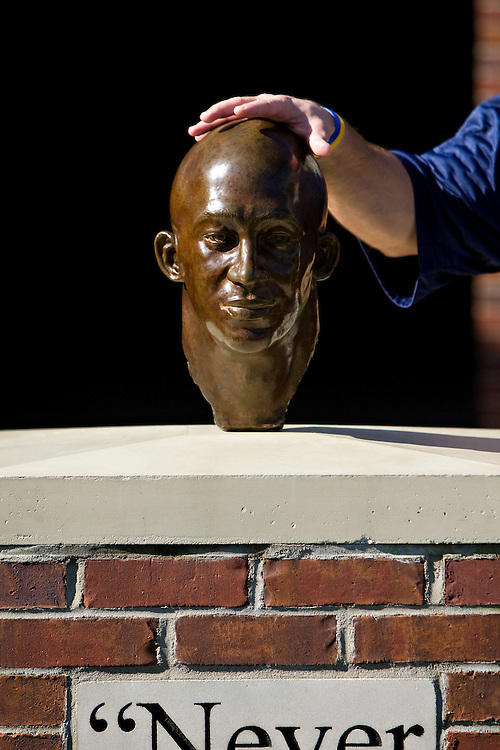 OXFORD, MS - OCTOBER 24:   Hand touches the bust of Chucky Mullins outside the locker room of the Ole Miss Rebels before a game against the Arkansas Razorbacks at Vaught-Hemingway Stadium on October 24, 2009 in Oxford, Mississippi.  The Rebels defeated the Razorbacks 30 to 17.  (Photo by Wesley Hitt/Getty Images) *** Local Caption ***