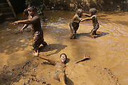 """Mepantigan, a mixture of wrestling, judo and traditional Bali martials arts, based on monkey characters, played in a muddy pool. Weird expressions are part of this strange ritual<br /><br />The Green School (Bali) is one of a kind in Indonesia. It is a private, kindergarten to secondary International school located along the Ayung River near Ubud, Bali, Indonesia. The school buildings are of ecologically-sustainable design made primarily of bamboo, also using local grass and mud walls. There are over 600 students coming from over 40 countries with a percentage of scholarships for local Indonesian students.<br /><br />The impressive three-domed """"Heart of School Building"""" is 60 metres long and uses 2500 bamboo poles. The school also utilizes renewable building materials for some of its other needs, and almost everything, even the desks, chairs, some of the clothes and football goal posts are made of bamboo.<br /><br />The educational focus is on ecological sustainability. Subjects taught include English, mathematics and science, including ecology, the environment and sustainability, as well as the creative arts, global perspectives and environmental management. This educational establishment is unlike other international schools in Indonesia. <br /><br />Renewable energy sources, including solar power and hydroelectric vortex, provide over 50% of the energy needs of the school. The school has an organic permaculture system and prepares students to become stewards of the environment. <br /><br />The school was founded by John and Cynthia Hardy in 2008."""