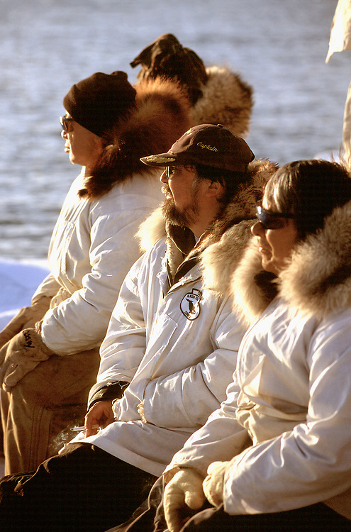Native whaling crew in the setting sun, watching for Bowhead whales in the chukchi Sea so hey can go hunting