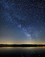 The brightest parts of the milky way are reflected in the calm waters of Spring Lake. It was a bit chilly on this night in mid-May, but the sky was perfectly clear which was great for seeing the milky way.<br />