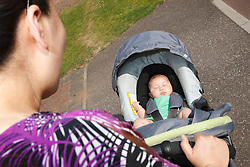 Chinese mother with baby in pram