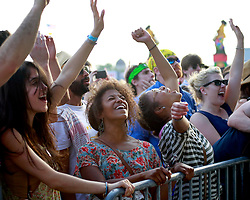 27 April 2013. New Orleans, Louisiana,  USA. .New Orleans Jazz and Heritage Festival. Enthusiastic fans cheer Andrew Bird at the Fais Do-Do stage..Photo; Charlie Varley.