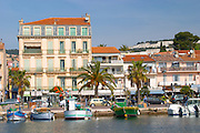 The harbour with boats and buildings along the water in Bandol Cote d'Azur Var France