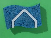 kitchen sponge hanging in holder