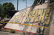 "An exterior wall of the destroyed Autozone building along Lake Street displays graffiti of George Floyd's final words ""I can't breathe"" in Minneapolis, Minnesota on Monday, June 1, 2020. The auto parts store was damaged extensively during the civil unrest in the final days of May following the death of George Floyd at the hands of Minneapolis Police Department officers."