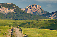 Gravel road approaching the Rocky Mountain Front Range near Choteau Montana