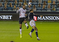 Football - Sky Bet Championship - Millwall vs Luton Town - The Den<br /> <br /> Sonny Bradley (Luton Town) beats Jake Cooper (Millwall FC) for the headed cross back toards the Millwall goal <br /> <br /> COLORSPORT/DANIEL BEARHAM