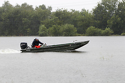 (170827) -- HOUSTON, Aug. 27, 2017 (Xinhua) -- A man riding his boat tries to help others voluntarily in great Houston area, Texas, the United States, Aug. 27, 2017. Widespread and worsening flood conditions prompted the closure of nearly every major road in Houston as the outer bands of Hurricane Harvey swept through the Houston area over the weekend. Latest news reports said the storm death toll has climbed to at least 5. (Xinhua/Song Qiong) (Photo by Xinhua/Sipa USA)