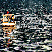 A lone fisherman fishes with a handline on the Bosphorus in Istanbul.