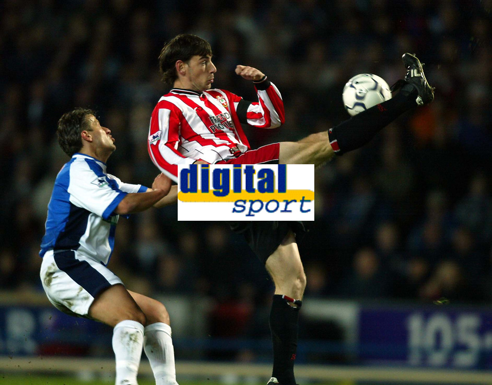 Blackburn's Tugay and Southampton's Rory Delap during the relegation dog-fight at Ewood Park,  Blackburn.<br /><br />Easter Monday April 1st 2002<br /><br />Pic by David Rawcliffe/Propaganda<br /><br />Any problems call David Rawcliffe - 07973 142020 - 07092 261 201 - david@propaganda-photo.com - http://www.propaganda-photo.com