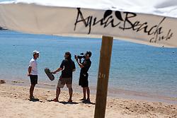 Alvaro Marinho gives a television interview in front of the Aqua beach Club. Poertimao Portugal Match Cup 2010. World match Racing Tour. Portimao, Portugal. 23 June 2010. Photo: Gareth Cooke/Subzero Images
