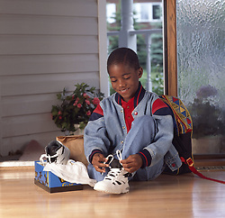 July 21, 2019 - Boy Tying His New Shoe (Credit Image: © Ron Nickel/Design Pics via ZUMA Wire)