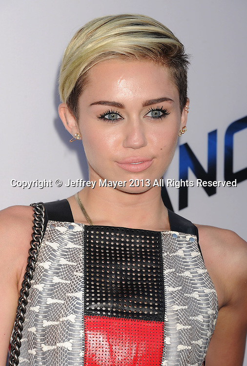 LOS ANGELES, CA- AUGUST 08: Actress/singer Miley Cyrus arrives at the 'Paranoia' - Los Angeles Premiere at DGA Theater on August 8, 2013 in Los Angeles, California.