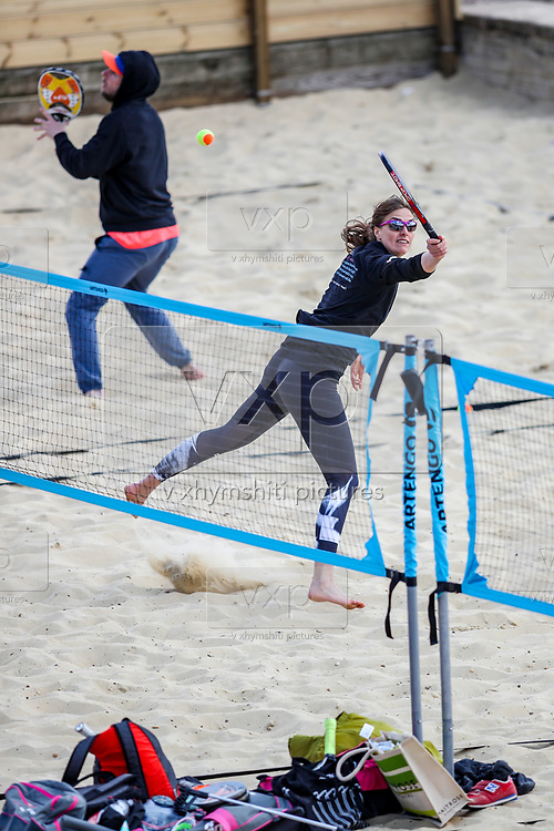 People enjoy the Sunny weekend with different sports activities along the Brighton Beach on Sunday, April 11, 2021. <br /> On Monday, April 12, England enters the next stage of government's roadmap out of lockdown, when the non-essential shops, outdoor hospitality, and personal services including hairdressing can open again. (Photo/ Vudi Xhymshiti)