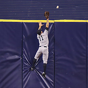 New York Yankees left fielder Brett Gardner (11) can't make the catch to avoid a home run hit by Evan Langoria during a major league baseball game between the New York Yankees and the Tampa Bay Rays at Tropicana Field on Thursday, Sept. 17, 2014 in St. Petersburg, Florida. The Yankees won the game 3-2 and this was Jeter's last game against Tampa Bay. (AP Photo/Alex Menendez)