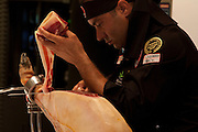 Nico Jimenez from Spain, breaks the world record for the longest slice of meat with an Iberico Ham from sposor, Iberselec, that he sliced to a length of 13 metres, 35 centimetres. This broke his own world record, set in 2008, by three centimetres. Hattori school of nutrition, Yoyogi, Tokyo, Japan. September 23rd 2010