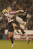 Photo: Aidan Ellis.<br /> Sheffield United v Manchester City. The Barclays Premiership. 26/12/2006.<br /> Sheffield's Rob Hulse battles with City's Micah Richards (R)