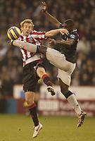Photo: Aidan Ellis.<br /> Sheffield United v Manchester City. The Barclays Premiership. 26/12/2006.<br /> Sheffield's Rob Hulse battles with City's Micah Richards (R)