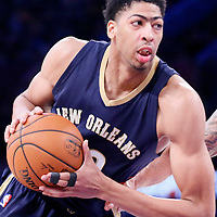 07 December 2014: New Orleans Pelicans forward Anthony Davis (23) drives past Los Angeles Lakers center Robert Sacre (50) during the New Orleans Pelicans 104-87 victory over the Los Angeles Lakers, at the Staples Center, Los Angeles, California, USA.