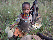 A young girl collecting Baobab fruits, extremely rich in Vitamin C. At the Hadza camp of Senkele.