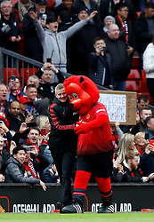 Manchester United interim manager Ole Gunnar Solskjaer greets mascot Fred the Red during the Premier League match at Old Trafford, Manchester.