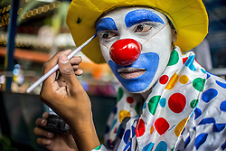 October 24, 2016 - Sao Paulo, Brazil - A clown adjusts his makeup before a protest by a group of clowns in the old center of Sao Paulo. They are protesting against bad clowns scaring people. The wave of evil clowns started in the US and has spread to many countries. (Credit Image: © Cris Faga via ZUMA Wire)