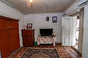 """Reception room of the half-built house of the Gregorian family pictured on Thursday, Dec 24, 2020 - in Çartar, which is about 47/km far from Stepanakert (Xankendi) in eastern Nagorno Karabakh.<br /> Alosha was reportedly killed in his position by an Azerbaijani shell the family say. """"He was a sniper shooter"""" his father Alihan remembers. Alosha was the father of three children. Two daughters and one son. From the age of 8 from his daughter to 12 years of his son and 15 years of age of his older daughter.<br /> During 44 days of the war, the region saw an end of the conflict after a ceasefire agreement was signed by the leaders of Armenia, Russia and Azerbaijan on 9 November to end the military conflict in Nagorno-Karabakh. Azerbaijani government established the Karabakh Region Authority (KRU) for the districts of Nagorno-Karabakh that came under Baku's control. The city of Stepanakert (Khankendi) is now under the jurisdiction of the KRU of the Ministry of Justice of Azerbaijan. (Photo/ Vudi Xhymshiti)"""