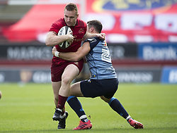 September 30, 2017 - Limerick, Ireland - Rory Scannell of Munster tackled by Steven Shingler of Cardiff during the Guinness PRO14 Conference A Round 5 match between Munster Rugby and Cardiff Blues at Thomond Park in Limerick, Ireland on September 30, 2017  (Credit Image: © Andrew Surma/NurPhoto via ZUMA Press)