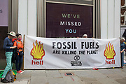 Environmental activists from Extinction Rebellion hold a banner referring to fossil fuels during the first day of Impossible Rebellion protests on 23rd August 2021 in London, United Kingdom. Extinction Rebellion are calling on the UK government to cease all new fossil fuel investment with immediate effect.