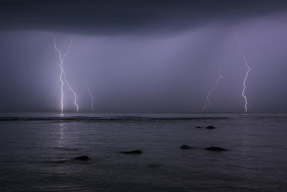 Multiple thunderbolts strikes sea surface at stormy night, Baltic sea near Salacgrīva, Latvia Ⓒ Davis Ulands | davisulands.com