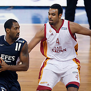 Galatasaray's Joshua Ian SHIPP (R) and Efes Pilsen's Bootsy THORNTON (L) during their BEKO Basketball League derby match Galatasaray between Efes Pilsen at the Abdi Ipekci Arena in Istanbul at Turkey on Sunday, March 06 2011. Photo by TURKPIX
