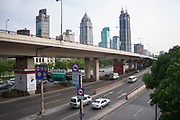 Overhead expressway in Shanghai, China. In addition to the buses, taxis and transport vehicles on Shanghais busy streets, personal car use is increasing. The result is a city with very polluted air, and streets full of cars.