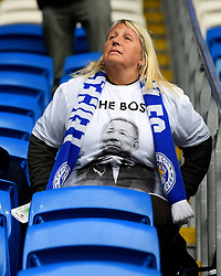 A Leicester City fan wears a shirt bearing a picture of Vichai Srivaddhanaprabha that reads 'The Boss' during the Premier League match at the Cardiff City Stadium, Cardiff.