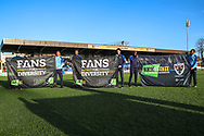 Kick it out banners on Kingsmeadow/ Cherry Red Records Stadium pitch during the EFL Sky Bet League 1 match between AFC Wimbledon and Peterborough United at the Cherry Red Records Stadium, Kingston, England on 18 January 2020.