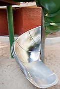 A metal slide for children curves around in a San Francisco Park.