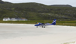 Barra Airport is a short-runway airport situated in the wide shallow bay of Traigh Mhòr at the north tip of the island of Barra in the Outer Hebrides, Scotland. Barra is now the only beach airport anywhere in the world to be used for scheduled airline services. Loganair Twin Otter taxiing for take off. (c) Stephen Lawson | Edinburgh Elite media