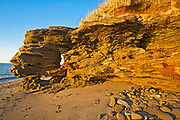 Rocky shoreline along  the Gulf of St. Lawrence at sunrise, Cap Lumiere, New Brunswick, Canada