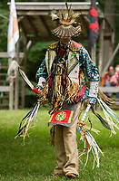Chris Backiel of Ossipee dances in the circle during the Inter Tribal dance in MicMac regalia on Saturday during the 48th annual Labor Day Pow Wow with LIHA in Sanbornton.  (Karen Bobotas/for the Laconia Daily Sun)
