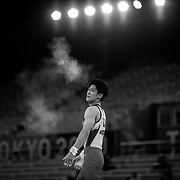 TOKYO, JAPAN - JULY 28: Chalk dust fills the air after Daiki Hashimoto of Japan clapped his hands in response to his performance on his final apparatus, the Horizontal Bar, which secured him the gold medal during the Men's All Round competition at Ariake Gymnastics Centre at the Tokyo 2020 Summer Olympic Games on July 28, 2021 in Tokyo, Japan. (Photo by Tim Clayton/Corbis via Getty Images)