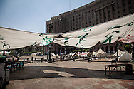 Temporary camps in Tahrir square, infront of a government administration building this morning.