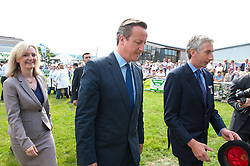 © Licensed to London News Pictures. 21/07/2014. Llanelwedd, UK. David Cameron and Liz Truss - newly appointed Secretary of State for Environment, Food and Rural Affairs since 2014 visit the sheep pen at the show.  A record numbers of visitors in excess of 240,000 are expected this week over the four day period of Europeís largest agricultural show. Livestock classes and special awards have attracted 8,000 plus entries, 670 more than last year. The first ever Royal Welsh Show was at Aberystwyth in 1904 and attracted 442 livestock entries. Photo credit: Graham M. Lawrence/LNP