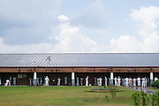 """SPRINGVILLE, AL – JUNE 25, 2015: <br /> Inmates stand in line to purchase snacks from the """"canteen"""" at St. Clair Correctional Facility in Springville, Alabama. <br /> The Alabama Justice Reinvestment Act (SB67), more commonly referred to as the Criminal Justice Reform Act, has received bi-partison support in the state of Alabama where aging prison infrastructure has not kept up with the demands of a rising inmate population. With prison facilities averaging 184% capacity, the bill attempts to alleviate overcrowding through a combination of sentencing reform and the expansion of supervised probation and local community corrections programs.<br /> As of June 2015, the Alabama Department of Corrections housed 24,511 inmates across 28 correctional facilities, representing a 470% increase in the inmate population since 1978. Although additions have been built at most facilities to accommodate more beds, infrastructure remains largely unchanged, limiting restrooms and kitchens to their original design capacity. In most facilities breakfast starts at 3:30 am, with lunch following at 9:30. """"You basically have to keep the kitchen going all day, just get everybody through,"""" said Dewayne Estes, warden at St. Claire Correctional Facility in Springville, Alabama. <br /> CREDIT: Bob Miller for The Daily Signal"""