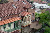 particular of Georgian traditional houses, view from above with roofs and balcons