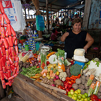 A food vendor sells her wares in an outdoor market in upper Belem, a crowded neighborhood in Iquitos, Peru.