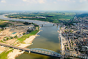 Nederland, Gelderland, Nijmegen, 26-06-2013; rivier de Waal met Waalbrug, gezien vanuit het Westen. Rechts binnenstad Nijmegen, links van de rivier grondwerkzaamheden voor de dijkteruglegging Lent (Ruimte voor de Rivier). De dijken worden landinwaarts verplaats en er wordt een nevengeul gegraven. De huizen op de dijk blijven bestaan en komen te liggen op het Stadseiland Veur-Lent Nijmegen. <br /> Waal bridge on the river Waal and left of the river groundwork for the Dike relocation of Lent (project Ruimte voor de Rivier: Room for the River).<br /> luchtfoto (toeslag op standaard tarieven);<br /> aerial photo (additional fee required);<br /> copyright foto/photo Siebe Swart.