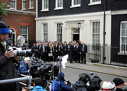 © under license to London News Pictures. LONDON. 05/05/2011. One year on since the last General Election. FILE PICTURE DATED.  11/05/10. Staff from number 10 and 11 Downing Street assemble along with the media to wait for Gordon Brown to emerge. British Prime Minister Gordon Brown has resigned his position and David Cameron has become the new British Prime Minister on May 11, 2010. The Conservative and Liberal Democrats are to form a coalition government after five days of negotiation. Photo credit should read Stephen Simpson/LNP