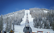 Skiers and riders take in the snow and the chairlifts at Monarch Mountain on a February day.