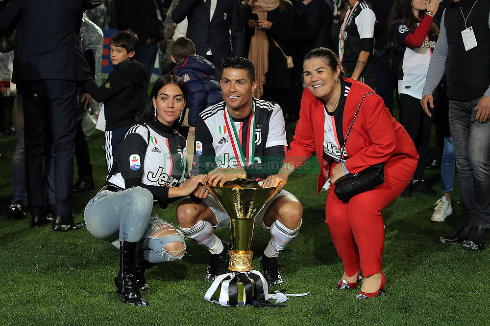 May 19, 2019 - Turin, Turin, Italy - Cristiano Ronaldo #7 of Juventus FC, Georgina Rodriguez and Maria Dolores dos Santos Aveiro celebrate with the trophy after winning the Serie A Championship at the end of the serie A match between Juventus FC and Atalanta BC at Allianz Stadium on May 19, 2019 in Turin, Italy. (Credit Image: © Giuseppe Cottini/NurPhoto via ZUMA Press)