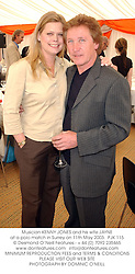Musician KENNY JONES and his wife JAYNE at a polo match in Surrey on 11th May 2003.		PJK 115